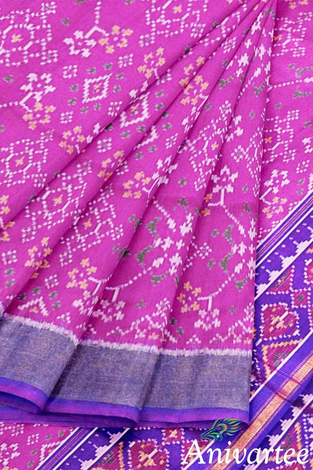 Beautiful handwoven Patola ikkat pure silk saree in pink in navaratan pattern.