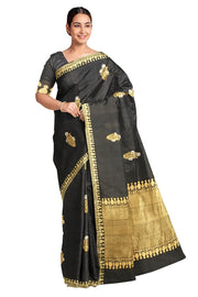 Handloom desi tussar silk saree in black with floral motifs in gold & silver