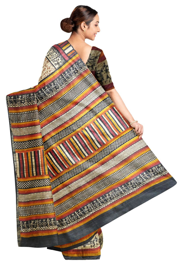 Handloom desi tussar pure silk saree in tribal art pattern with multicoloured striped border