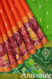 Uppada pure silk saree in orange with buttas and a skirt border in ikat pattern.