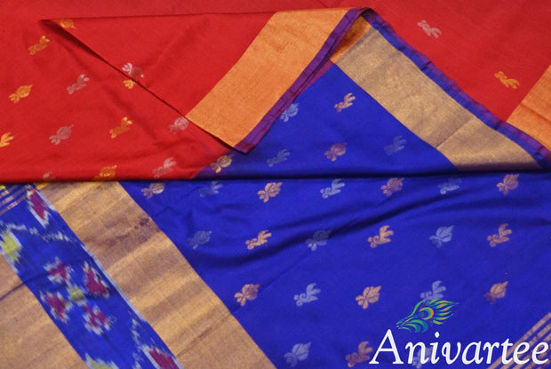 Uppada pure silk saree in red with buttas  on the body and a skirt border in Ikat pattern