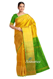 Uppada pure silk saree in yellow with buttas and 9 inch border & a contrast pallu