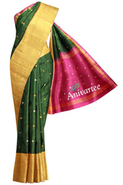 Uppada pure silk saree in dark green with buttas and 9 inch border & a contrast pallu