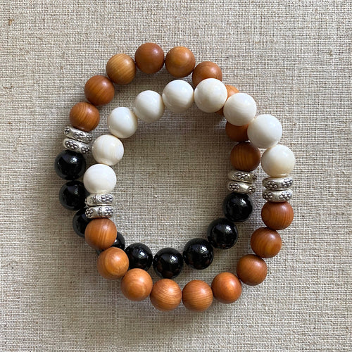Stack of Sandalwood, Black Tourmaline, and Tridacna Bracelets