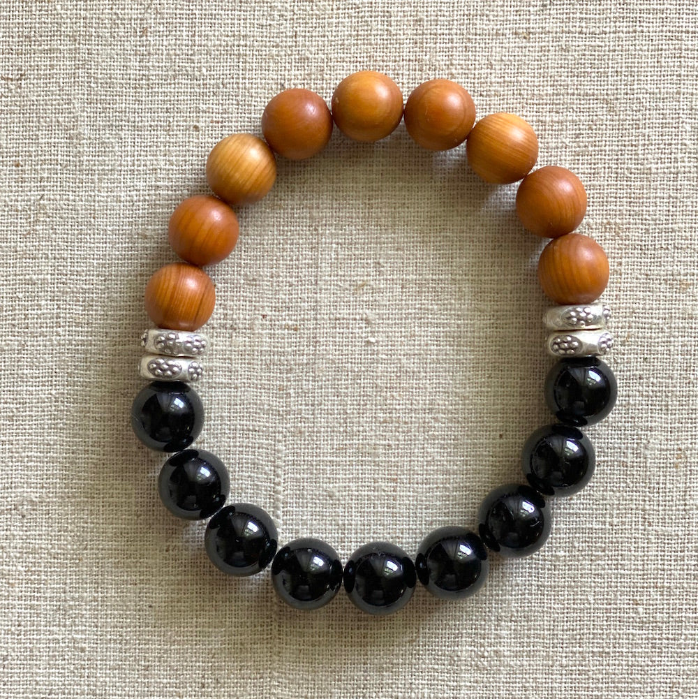 Sandalwood and Black Tourmaline bracelet.  Deeply grounding and healing.