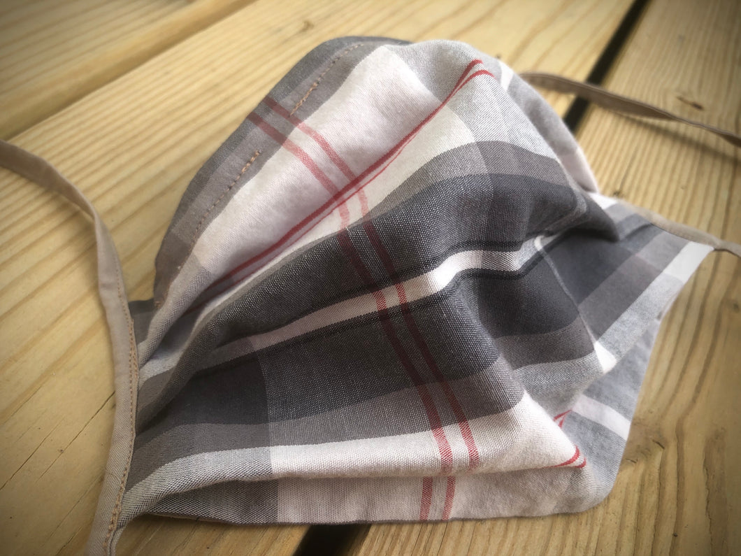 Grey plaid face covering with pocket for filter