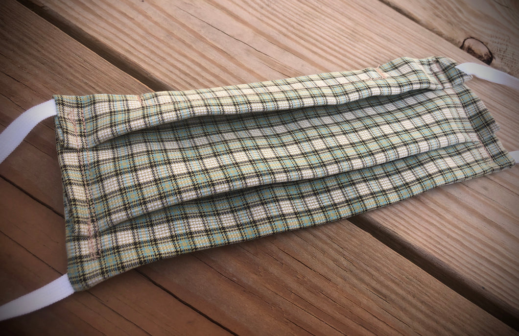 Green plaid face covering with pocket for filter
