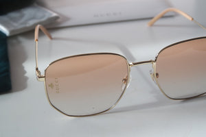 Gucci 0396S Gold Oversized Round Logo Sunglasses in Orange