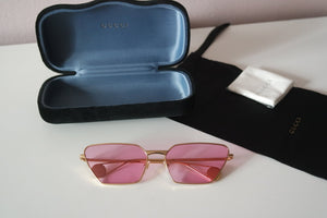 Gucci 0538S Metal Cat Eye Sunglasses in Pink