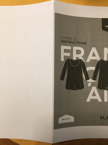 Instruction booklet sewn in the middle
