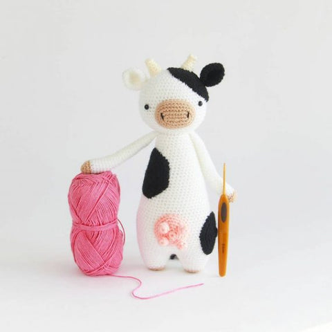 Tall Cow with yarn