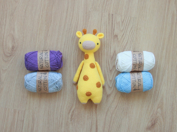 Giraffe amigurumi pattern by Little Bear Crochets with yarn skeins