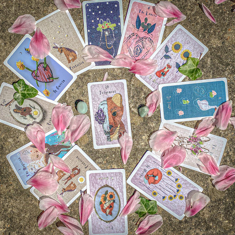 Photo by Kendra of selected cards from the embroidered forest tarot deck