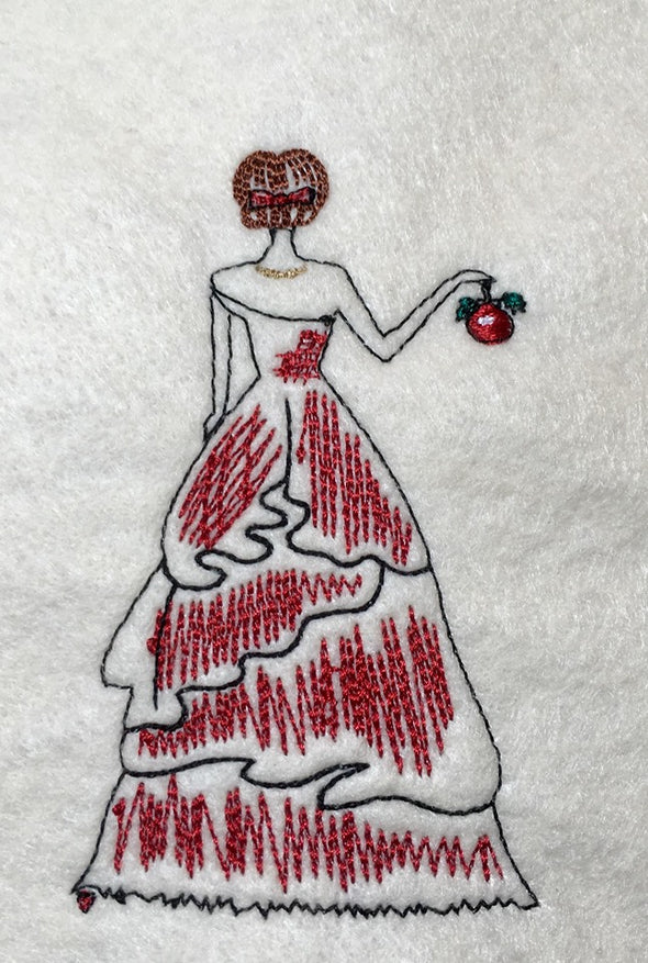 Back of Lady in Christmas Red Dress and Bauble in Hand