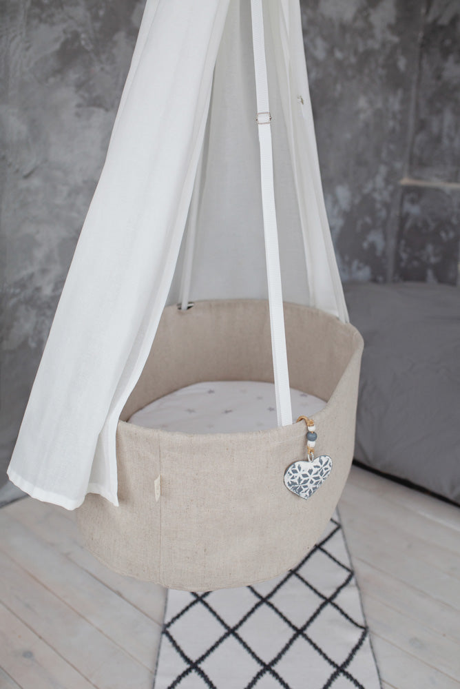 baby muslin swaddle, baby cradle, linen cradle, linen bassinet, linen hanging baby bed, best babyshower gift, best gift for expecting mother, snuggle lounger, sensory baby lounger, sensory newborn lounger hanging cradle with canopy, white cradle canopy, white canopy for baby bed