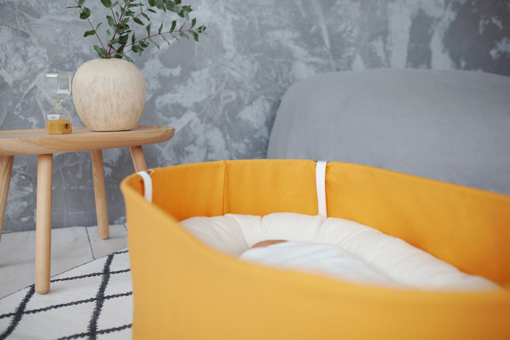 baby bassinet in yellow, sensory baby bassinet, sensory baby cradle, hanging baby cradle