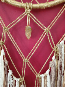 Stunning intricate macrame dreamcatcher in golden and creamy tones with natural Lemon Citrine