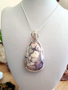 Rare creamy purple Tiffany Stone cabochon intricately wrapped in silver plated copper wire