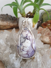 Load image into Gallery viewer, Rare creamy purple Tiffany Stone cabochon intricately wrapped in silver plated copper wire