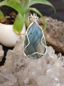Large Labradorite cabochon with flashy blue/gold colour wrapped in sterling silver