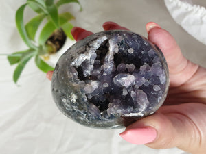 Grape Agate egg crystal specimen with druzy cave