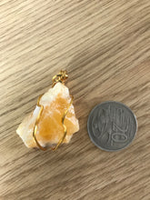 Load image into Gallery viewer, Orange Calcite pendant yellow gold plated copper wire wrapped