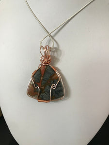 Red Marcasite cabochon pendant wrapped in rose gold