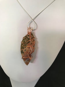 Pink and Brown Ocean Jasper pendant wrapped in antique copper