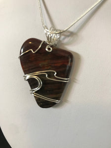 Tigers Eye pendant wrapped in sterling silver