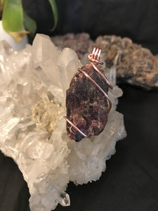Australian Natural Dravite pendant with rose gold wire wrapping.
