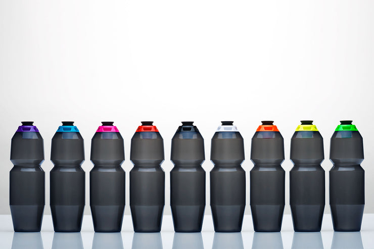 Nine, sleek, 24 ounce water bottles with different color caps.