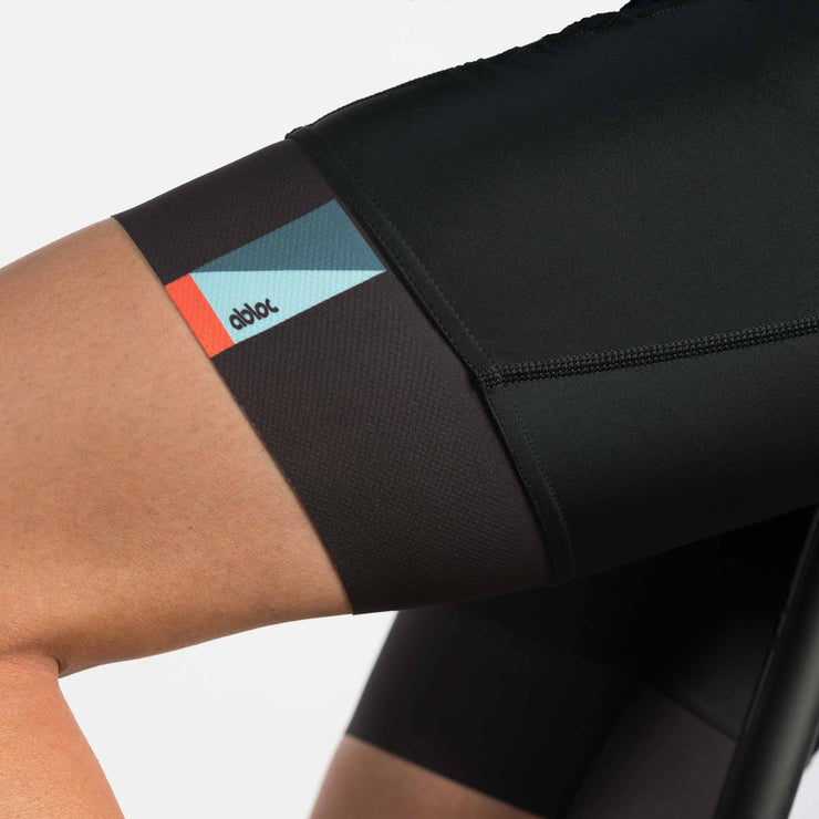 Close up of black cycling bib shorts on a male model.