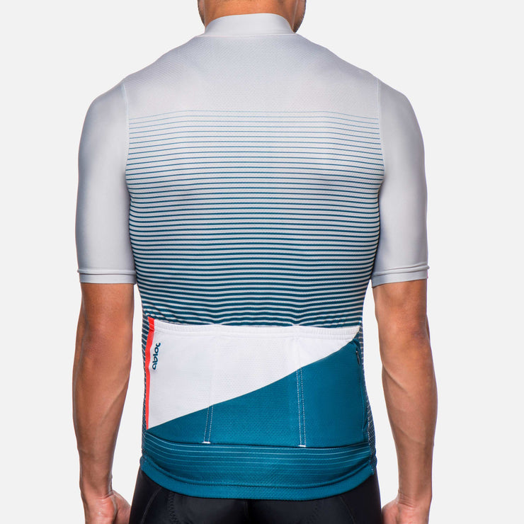 Light grey and blue, striped cycling jersey on a male model.