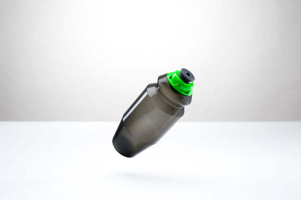 A sleek 18.5 ounce water bottle with a green cap.