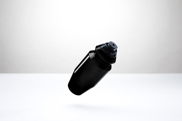 A sleek, opaque black, 18.5 ounce water bottle with a black cap.