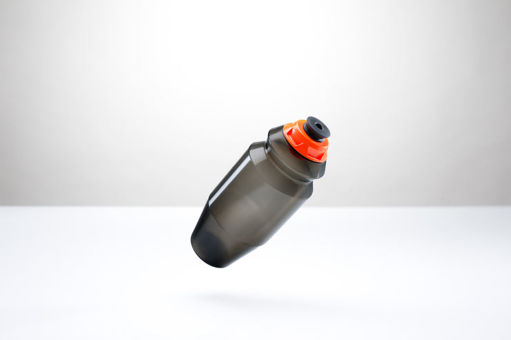 A sleek 18.5 ounce water bottle with an orange cap.