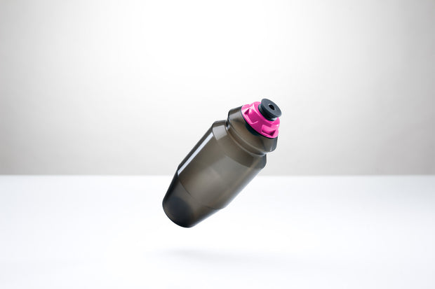 A sleek 18.5 ounce water bottle with a pink cap.