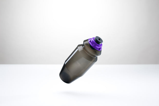 A sleek 18.5 ounce water bottle with a purple cap.