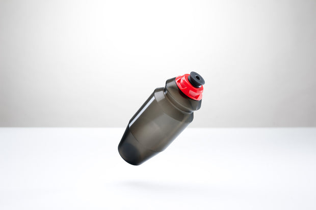 A sleek 18.5 ounce water bottle with a red cap.