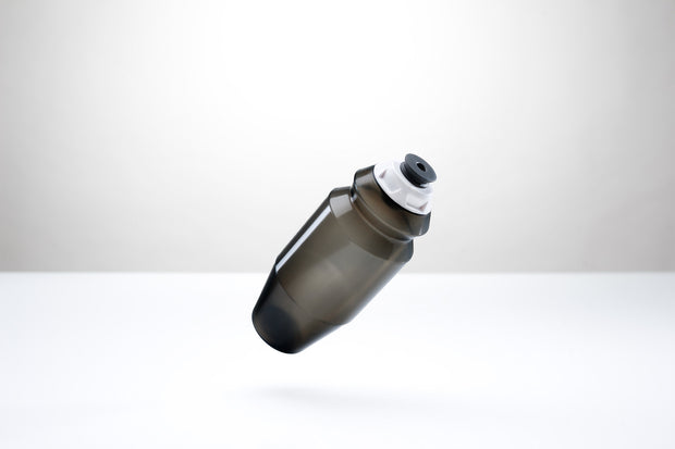 A sleek 18.5 ounce water bottle with a white cap.