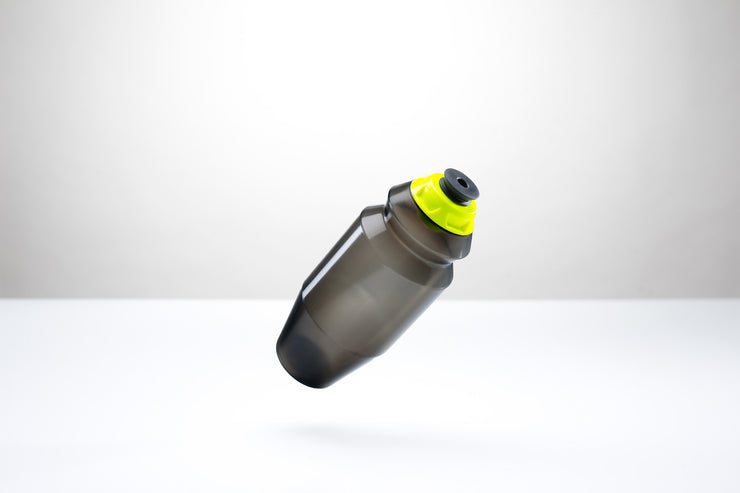 A sleek 18.5 ounce water bottle with a yellow cap.