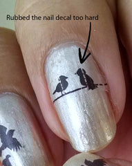 water slide nail decal with rubbed out lines running through the picture