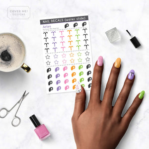 aries zodiac nail decals on table