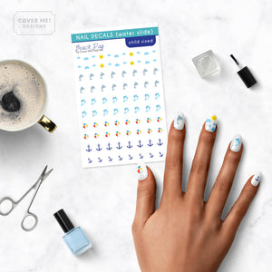 beach summer kid nail decals on table