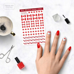 canadian flag nail decals with maple leaves on table