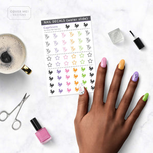 capricorn zodiac nail decals on table