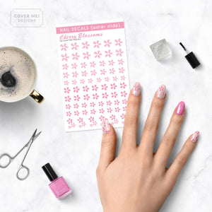 cherry blossom pink sakura nail decals on table