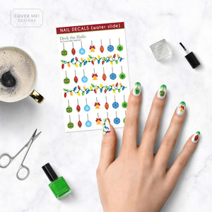 deck the halls christmas ornament nail decals on table