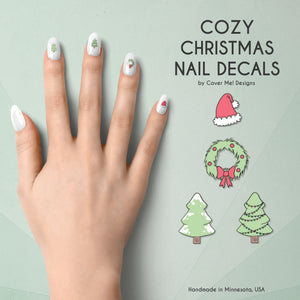 cozy christmas nail decals with santa hats, wreaths, and christmas trees