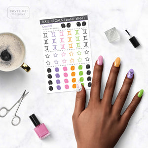 gemini zodiac nail decals on table